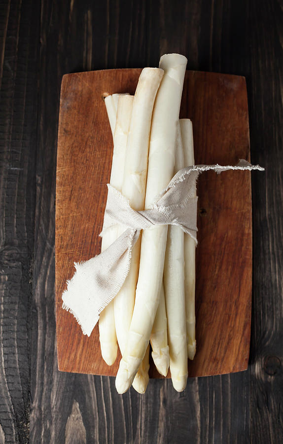 Bunch Of White Asparagus On Chopping Photograph by Westend61