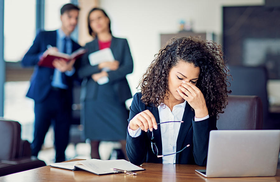 Burnout businesswoman under pressure in the office Photograph by Praetorianphoto