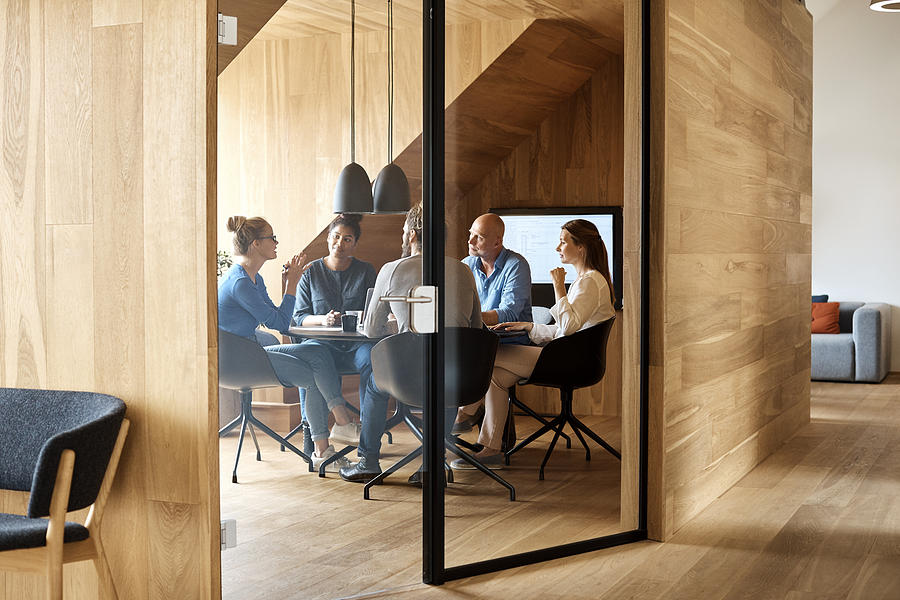 Business Executives Discussing In Office Meeting Photograph by Morsa Images