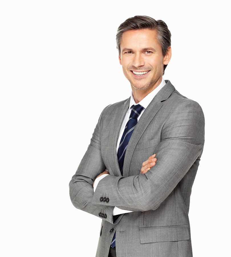 Business man smiling with arms crossed Photograph by GlobalStock