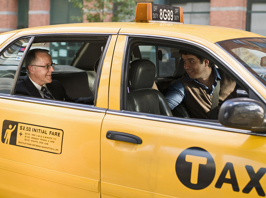 Business man talking with taxi driver Photograph by Aidon