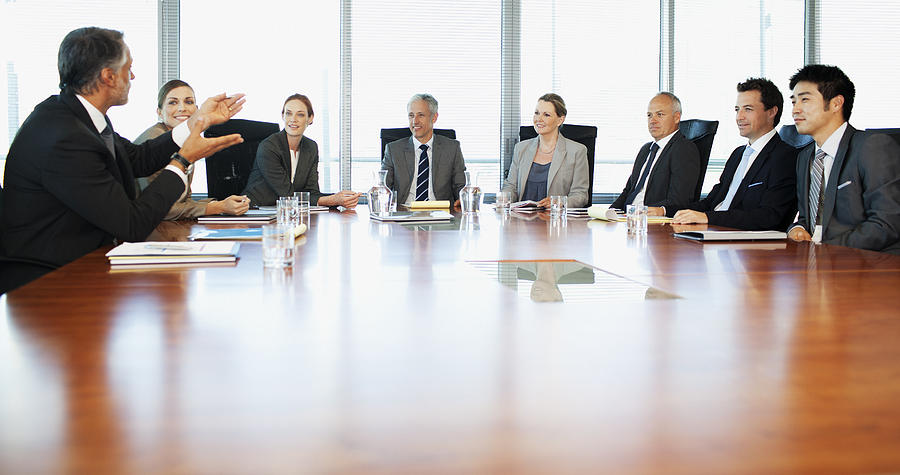 Business people meeting at table in conference room Photograph by Robert Daly