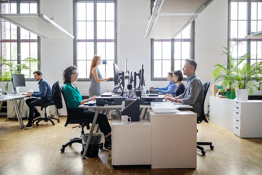 Business people working at a modern office Photograph by Alvarez
