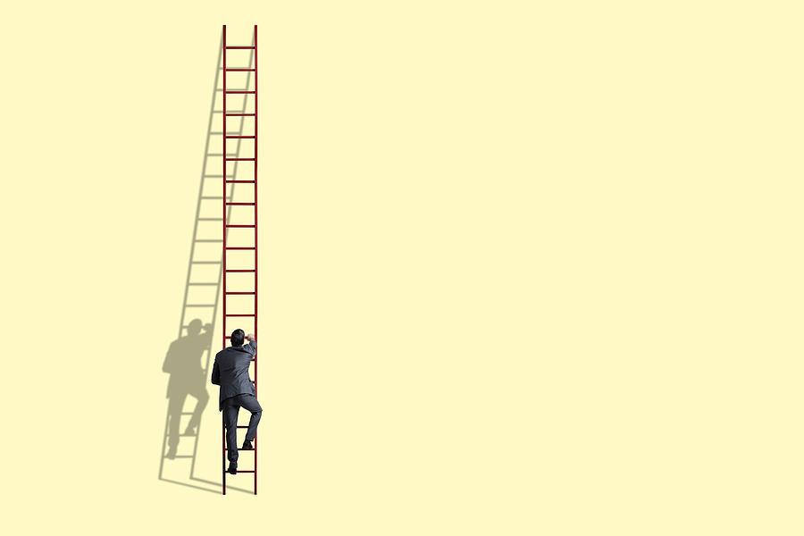 Businessman Climbing Ladder Photograph by Dny59