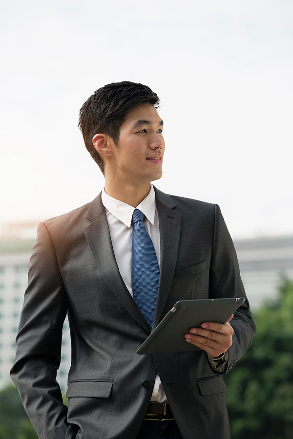 Businessman Holding Digital Tablet Photograph by Eternity In An Instant