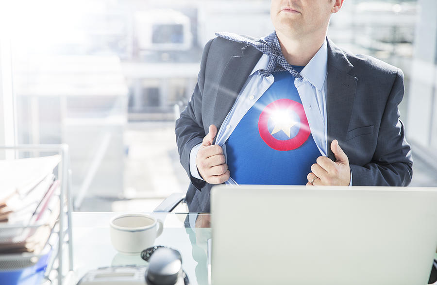 Businessman Opening Shirt To Reveal Superhero Costume Photograph by Robert Daly