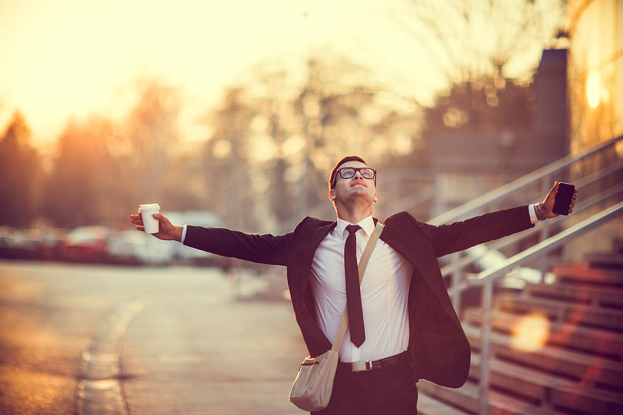 Businessman smiling with arms outstretched Photograph by Eclipse_images