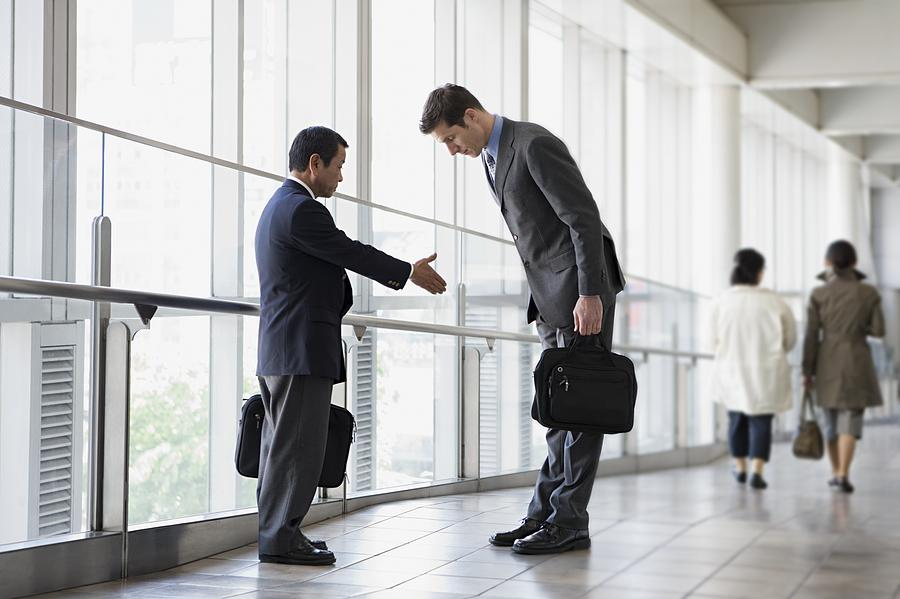Businessmen Greeting Photograph by Image Source