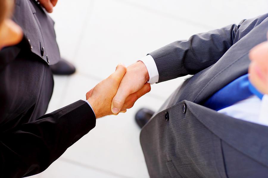 Businessmen shaking hands Photograph by Jacob Wackerhausen