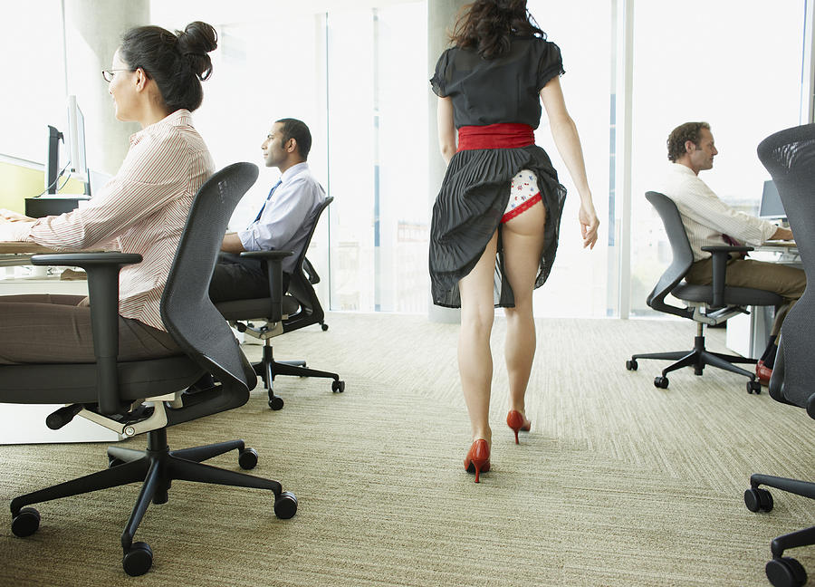 Businesswoman With Skirt Caught In Underwear Photograph by Paul Bradbury