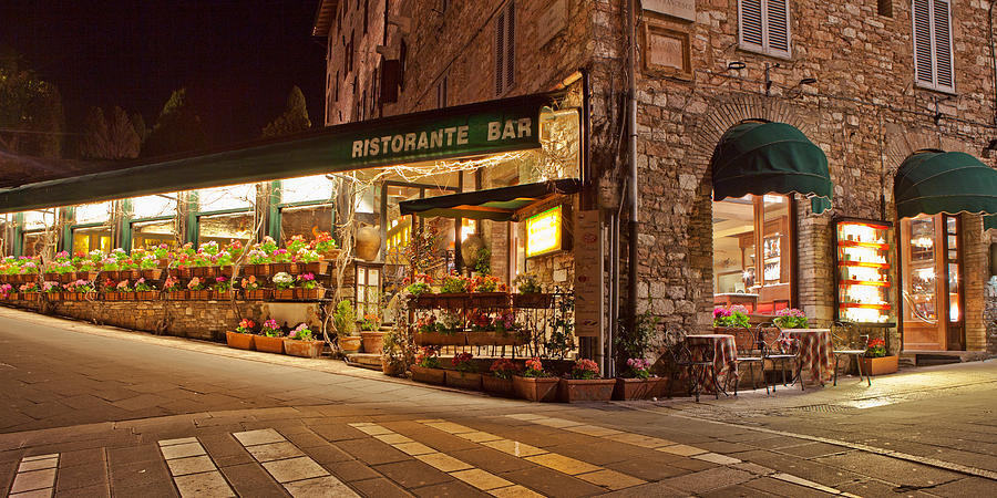 Store Photograph - Cafe In Assisi At Night by Susan Schmitz