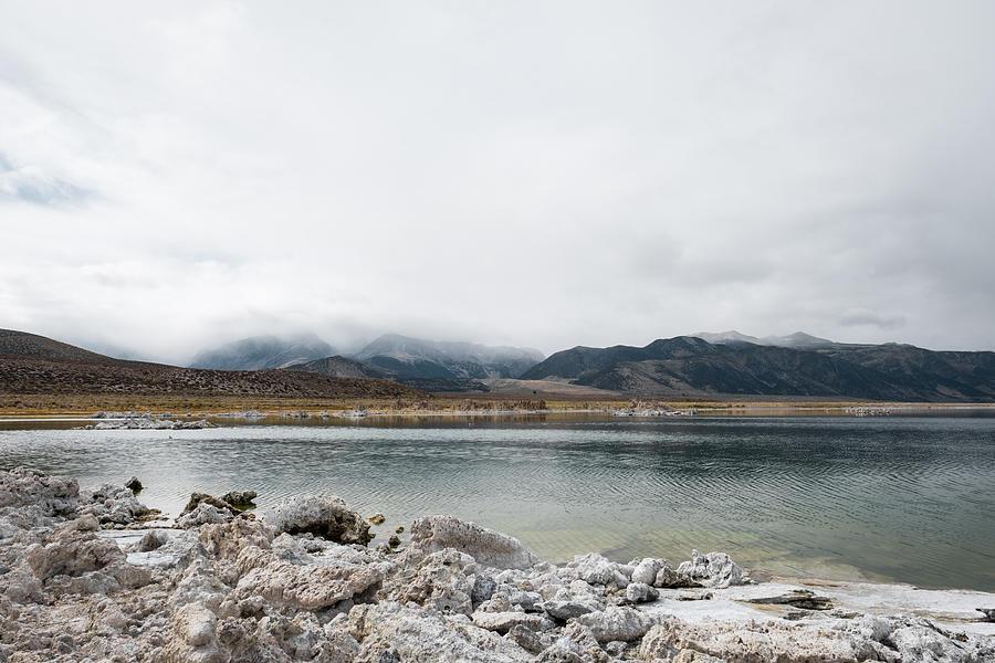 Calm Lake Against Mountain Range Photograph by Christian Soldatke / EyeEm