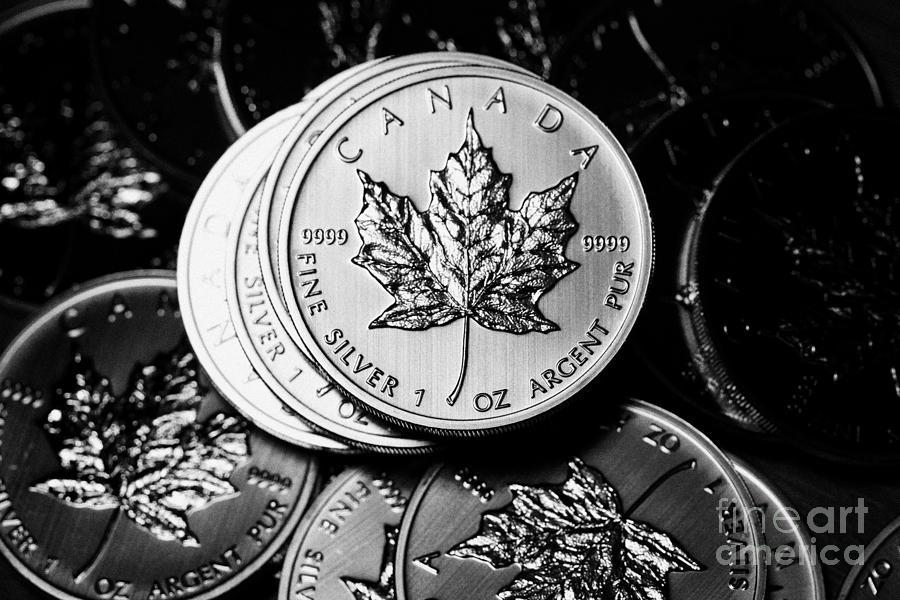 Silver Photograph - Canadian One Ounce Maple Leaf Silver Coins by Joe Fox