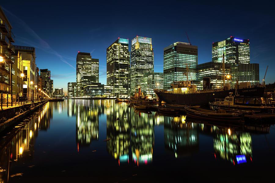 Standing Water Photograph - Canary Wharf At Night by Scott Baldock