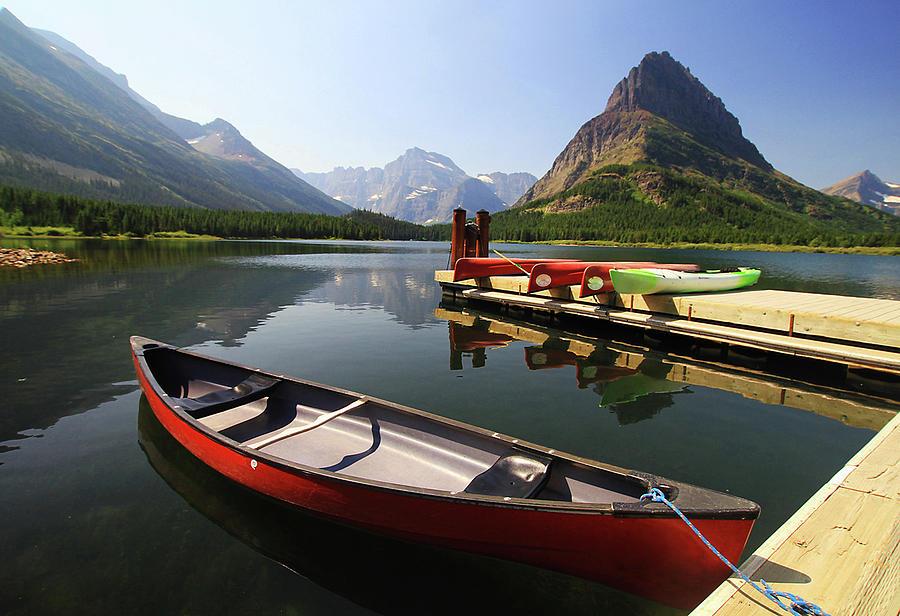 Canoe At St Mary Lake In Glacier Photograph by L. Toshio Kishiyama