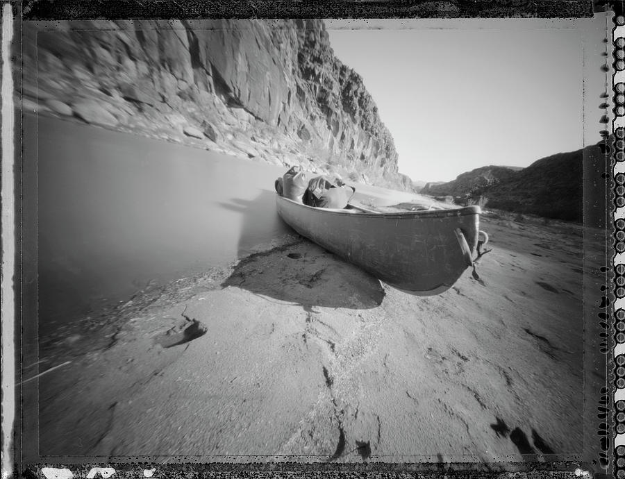 Adventure Photograph - Canoe Beached By The River by Joel Sheagren