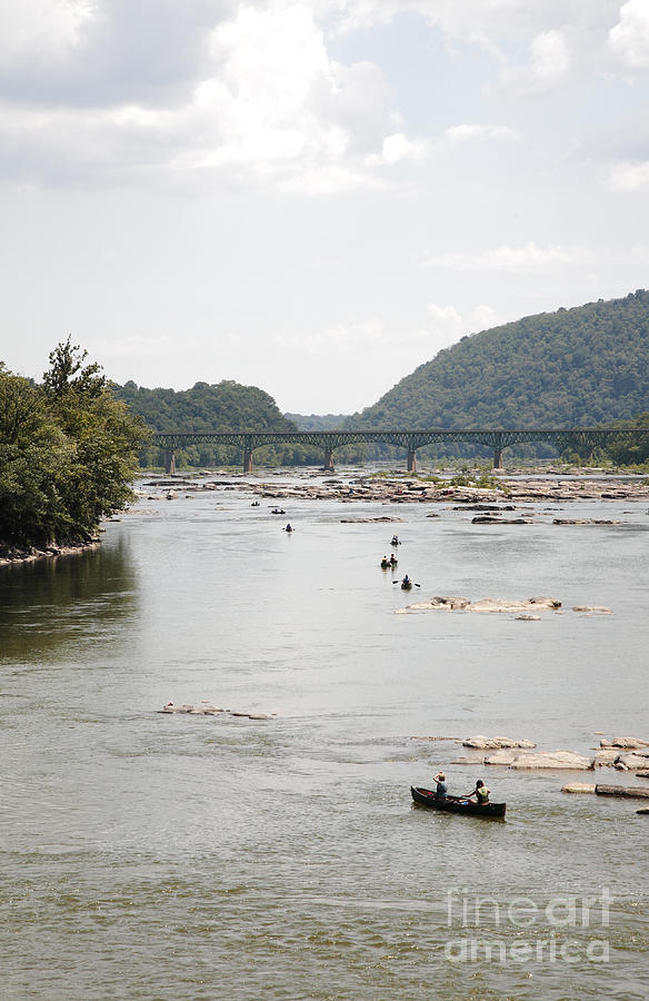 Canoe Photograph - Canoeing On The Potomac River At Harpers Ferry by William Kuta