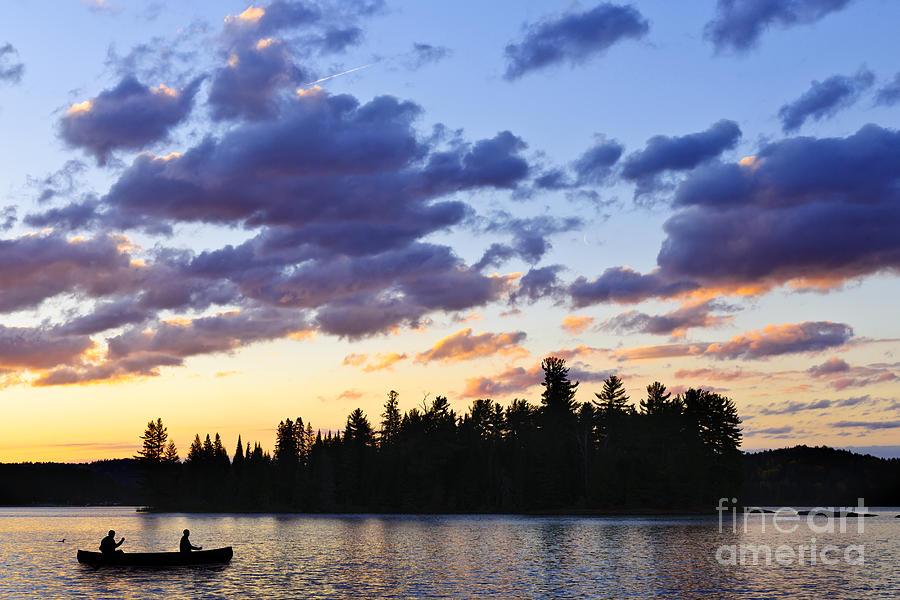 Sunset Photograph - Canoeing At Sunset by Elena Elisseeva