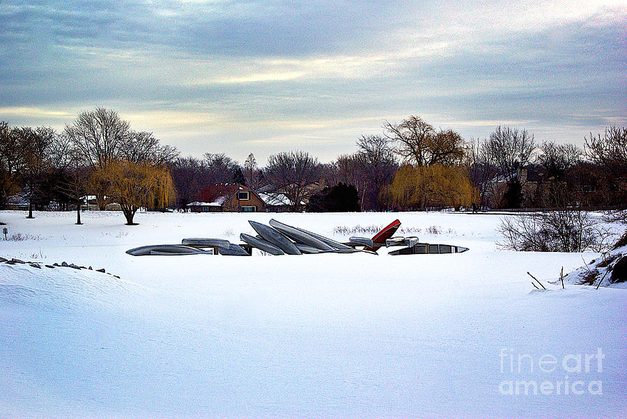 Canoes In The Snow Photograph