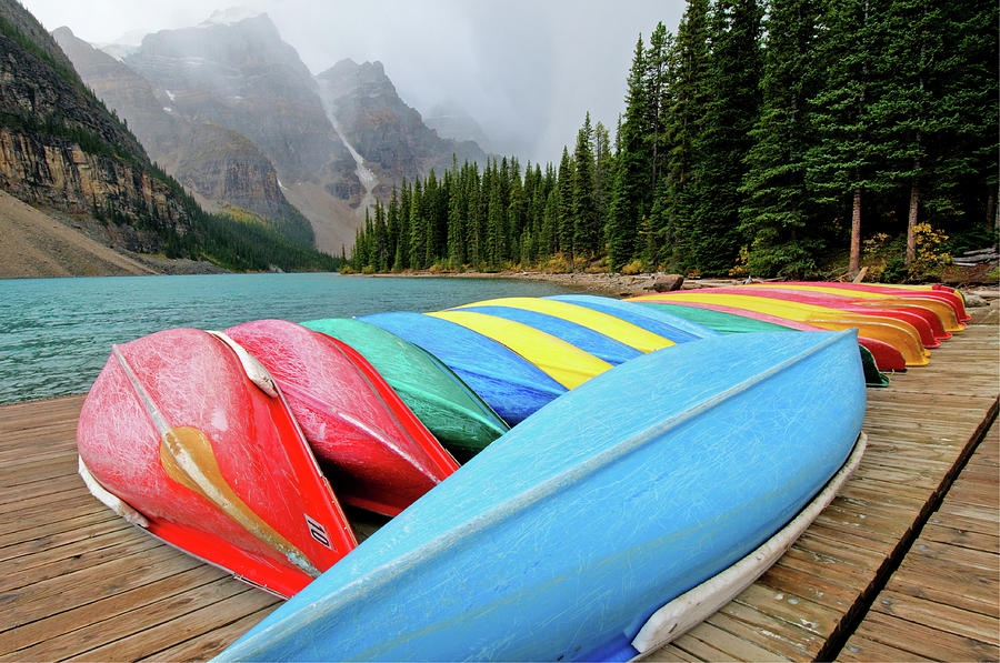 Canoes Line Dock At Moraine Lake, Banff Photograph by Wildroze