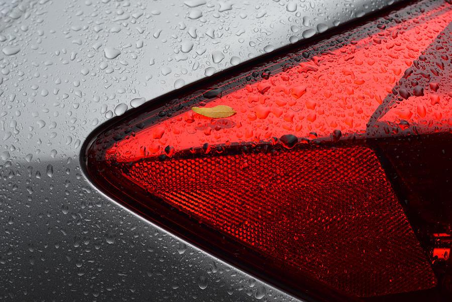 Car after rain by Dragan Kudjerski