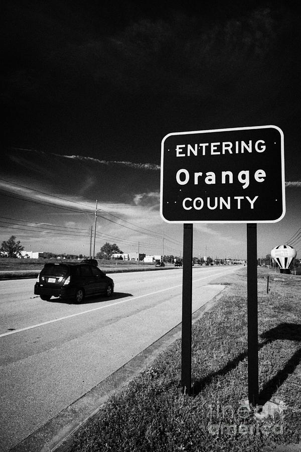 Entering Photograph - Car Entering Orange County On The Us 192 Highway Near Orlando Florida Usa by Joe Fox