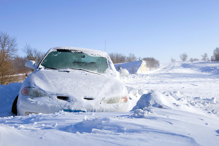 Car Stuck in Snow off an Interstate Highway Photograph by BanksPhotos