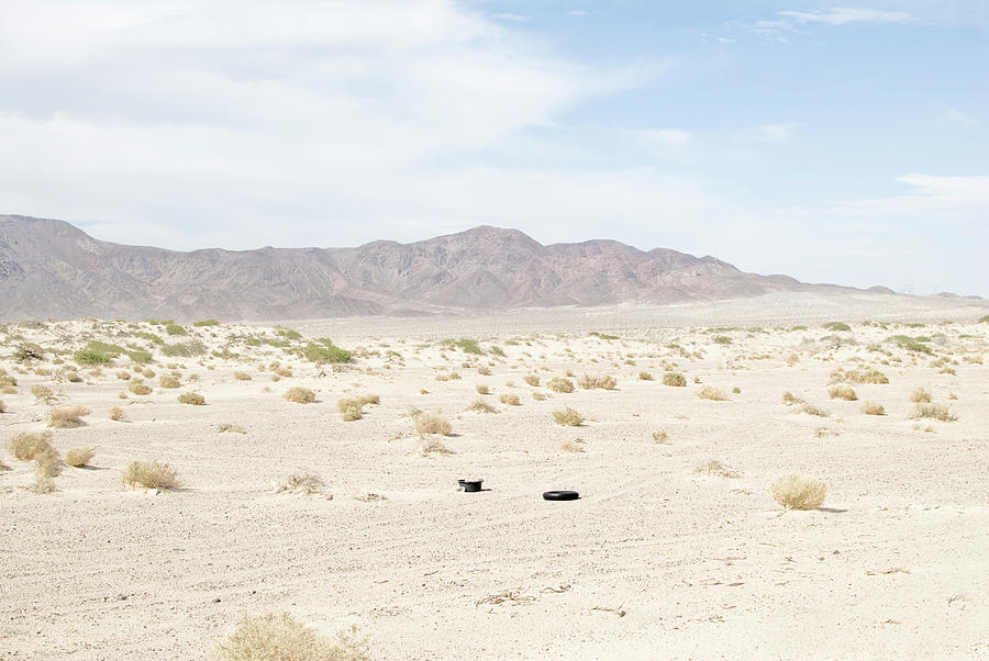 Car Tire In Desert Photograph by Peter Starman