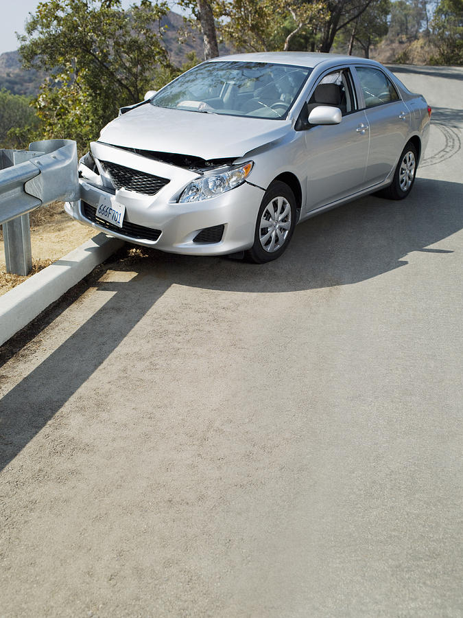 Car Wrecked On Road Guardrail Photograph by Chris Ryan