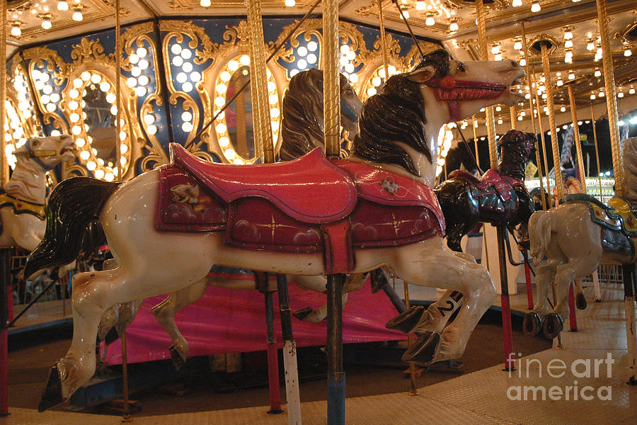 Fun Rides Photograph - Carnival Festival Merry Go Round Carousel Horses  by Kathy Fornal