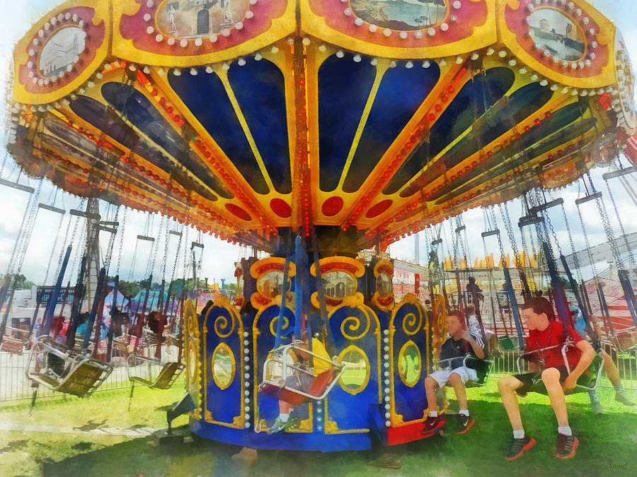 Ride Photograph - Carnival - Super Swing Ride by Susan Savad