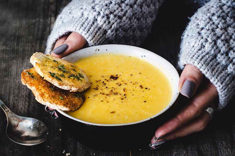 Carrot Pumpkin Cream Soup With Garlic Bread Photograph by Arx0nt