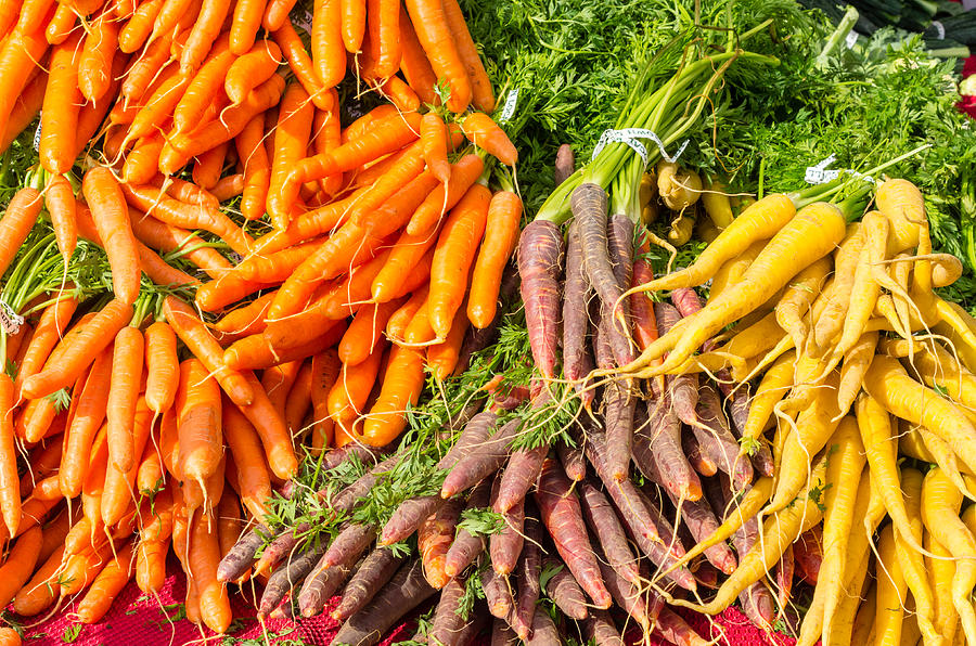 Agriculture Photograph - Carrots At The Market by John Trax