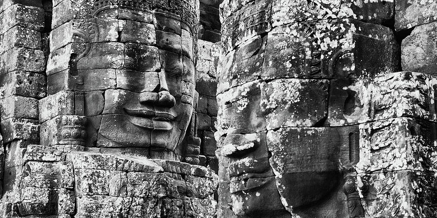 Horizontal Photograph - Carved Stone Faces In The Khmer Temple by Panoramic Images