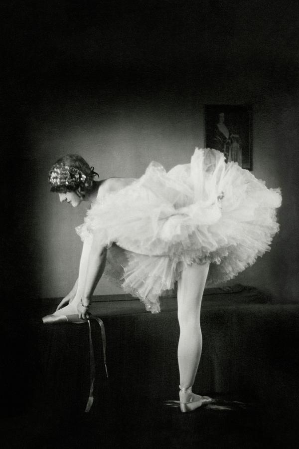 Catherine Crandell Tying Her Ballet Shoes Photograph by Francis Bruguiere