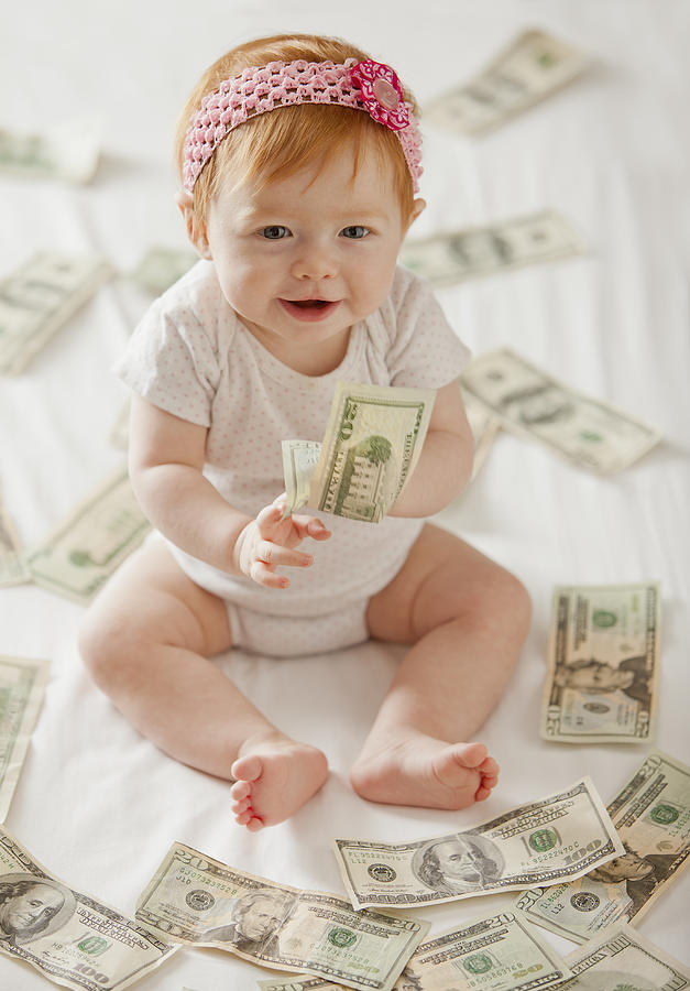 Caucasian baby girl playing with twenty dollar bills Photograph by Mike Kemp