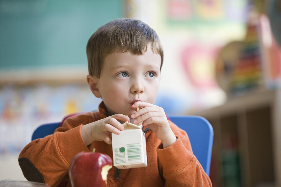 Caucasian Boy Eating Lunch In Classroom Photograph by Jose Luis Pelaez Inc
