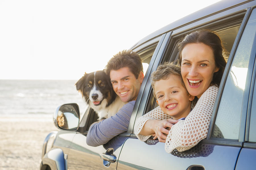 Caucasian family in car windows on beach Photograph by Jacobs Stock Photography Ltd