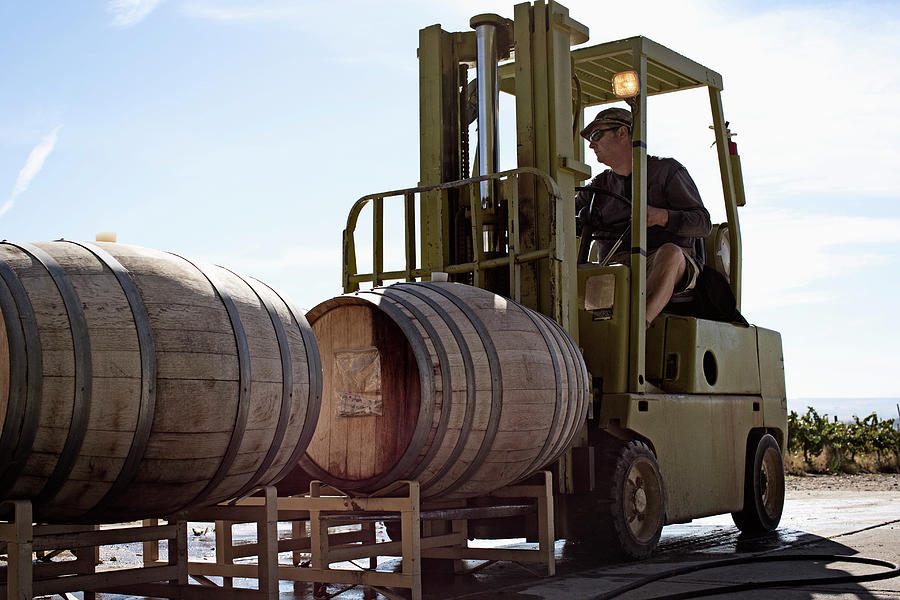 Caucasian Farmer Driving Forklift With Photograph by Hill Street Studios