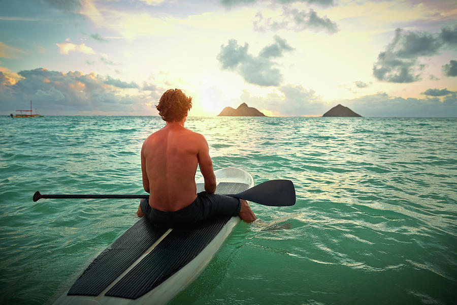 Caucasian Man On Paddle Board In Ocean Photograph by Colin Anderson Productions Pty Ltd