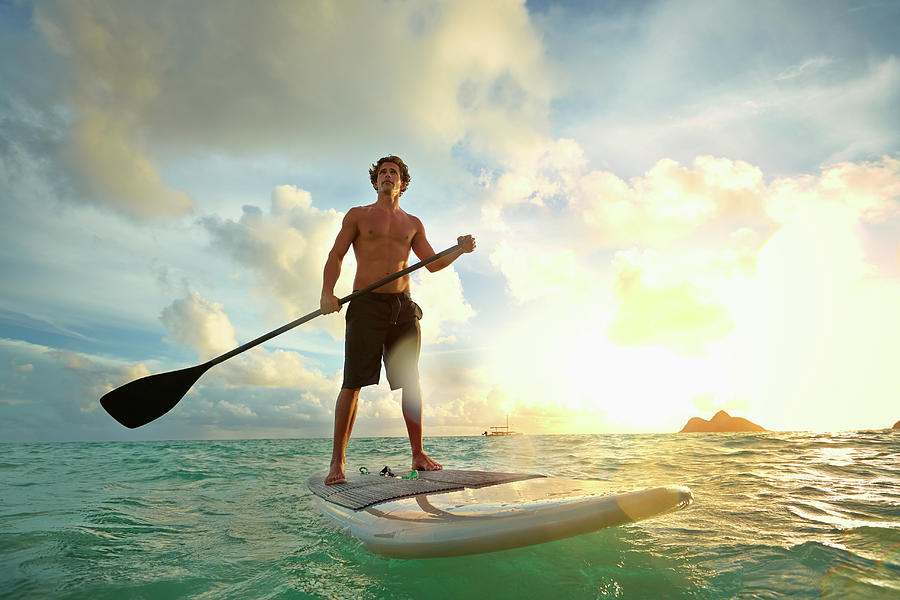 Caucasian Man On Paddle Board In Water Photograph by Colin Anderson Productions Pty Ltd
