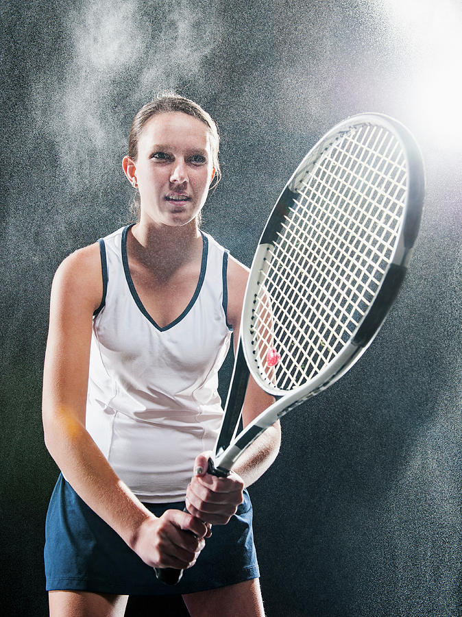 Caucasian Tennis Player In Rain Photograph by Erik Isakson