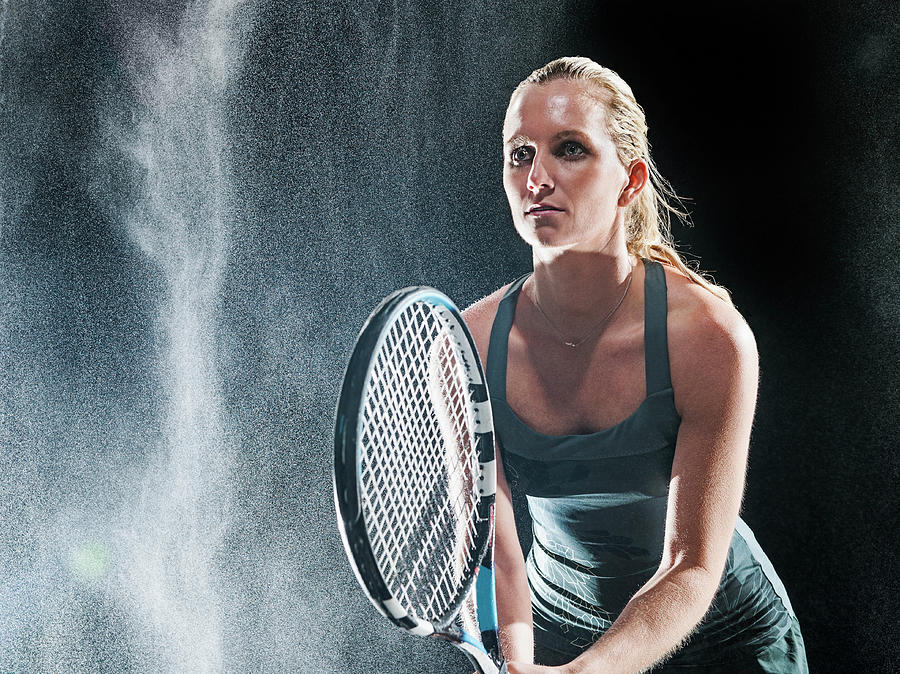 Caucasian Tennis Player Standing In Rain Photograph by Erik Isakson