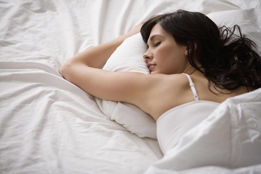 Caucasian woman sleeping in bed Photograph by John Fedele