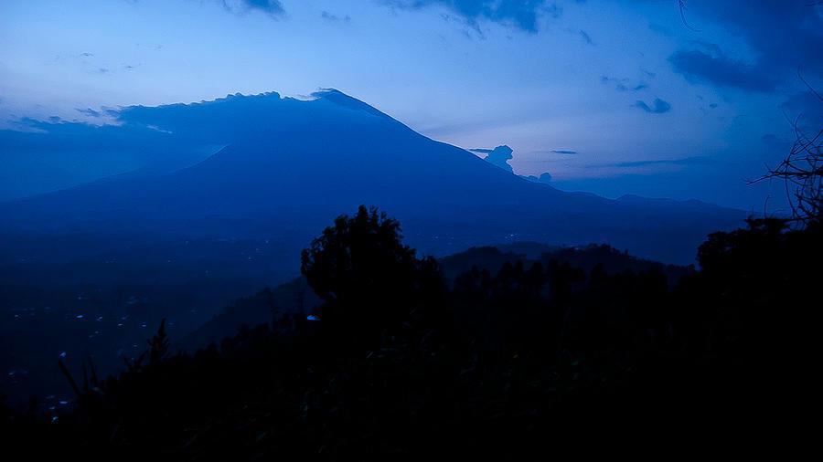 Rwanda Photograph - Celestial Volcano by Paul Weaver
