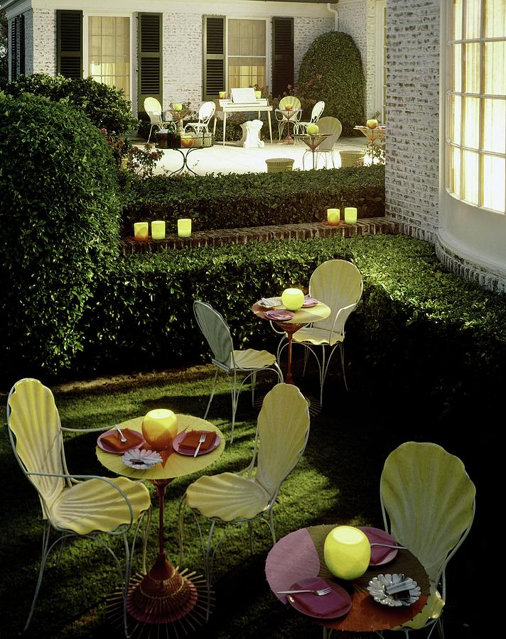Chairs And Tables In A Garden Photograph by Ernst Beadle