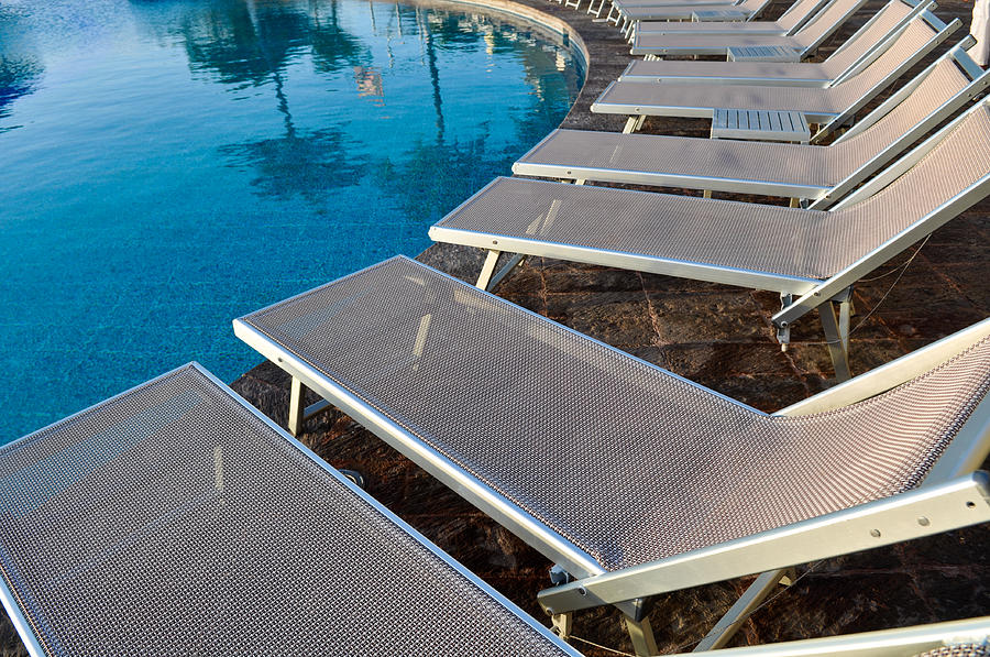 Nobody Photograph - Chairs Around Hotel Pool by Brandon Bourdages
