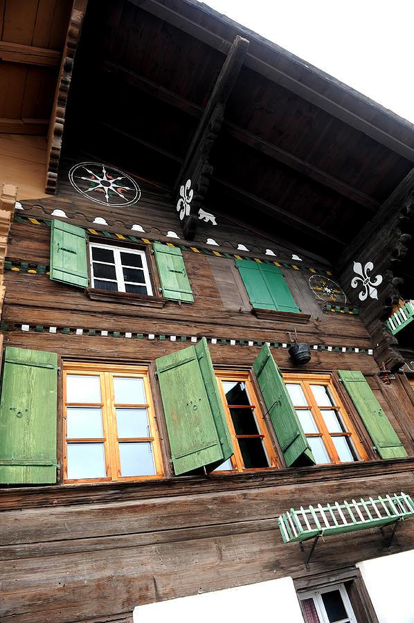 Swiss Photograph - Chalet Windows by Stephen Richards