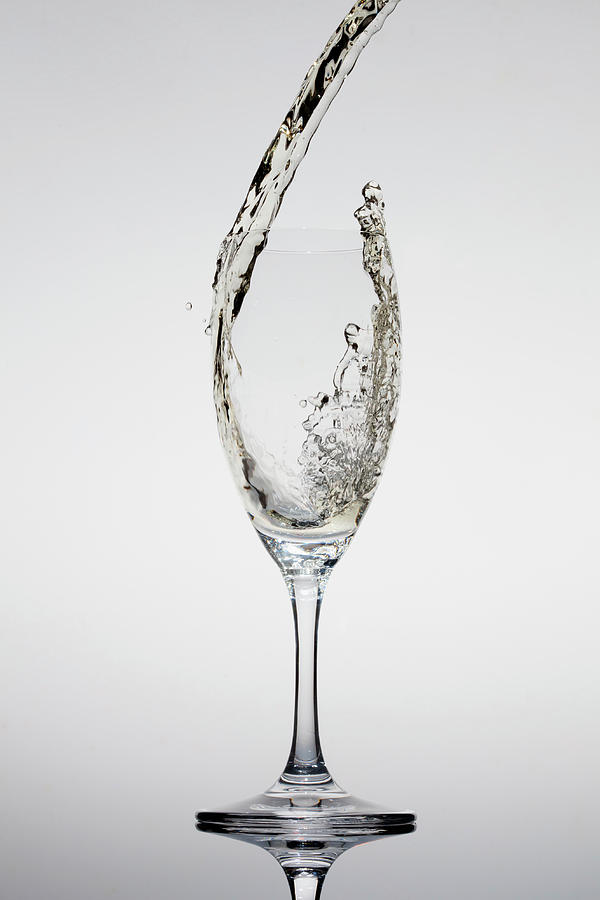Champagne Being Poured Into A Glass Photograph by Dual Dual