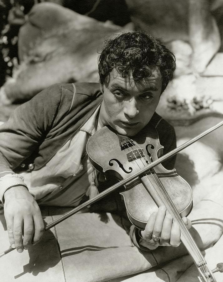 Charles Boyer Playing A Violin Photograph by George Hoyningen-Huene